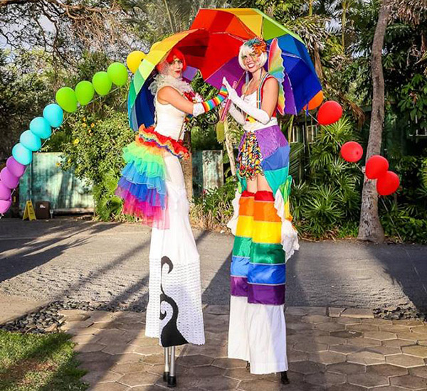 rainbow stilt walkers