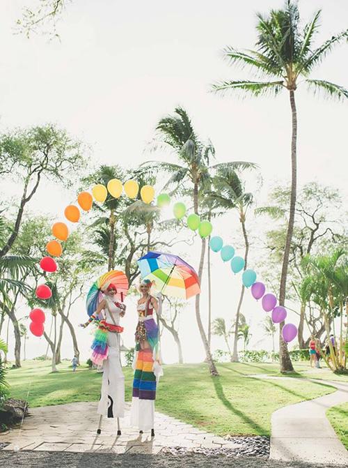 rainbow stilt walkers